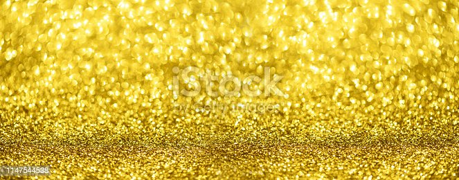 881350776 istock photo Banner with defocused lights, bright yellow bokeh. Golden shiny background, copy space for your Christmas greetings. Shimmer of gold glitter texture. Concept of New year, luxury holiday. 1147544538