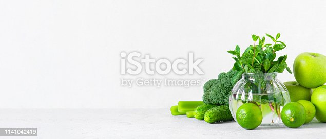 istock Banner with fresh green vegetables and fruits for healthy eating 1141042419