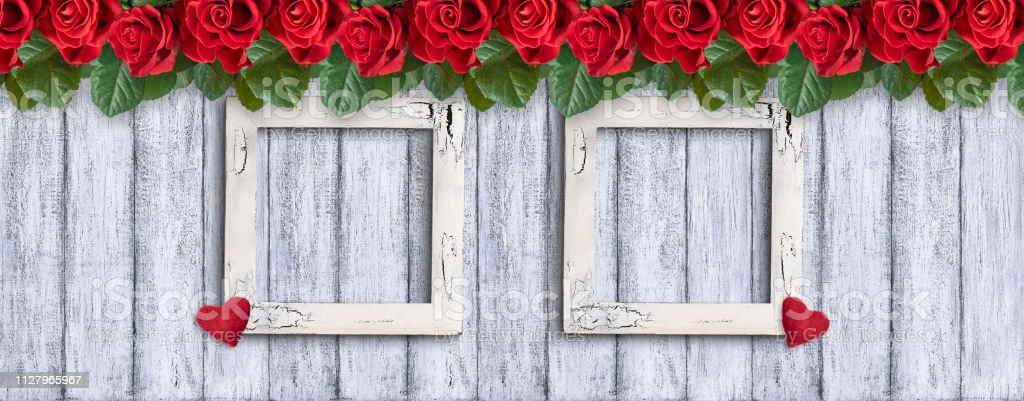 Banner with red roses, Valentines hearts, two empty photo frames on...