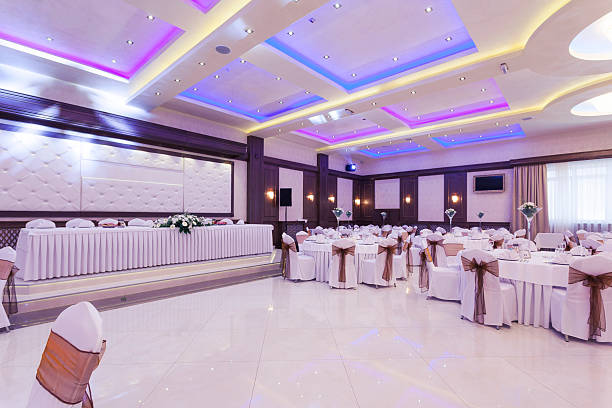 Banquet hall with colorful lights stock photo