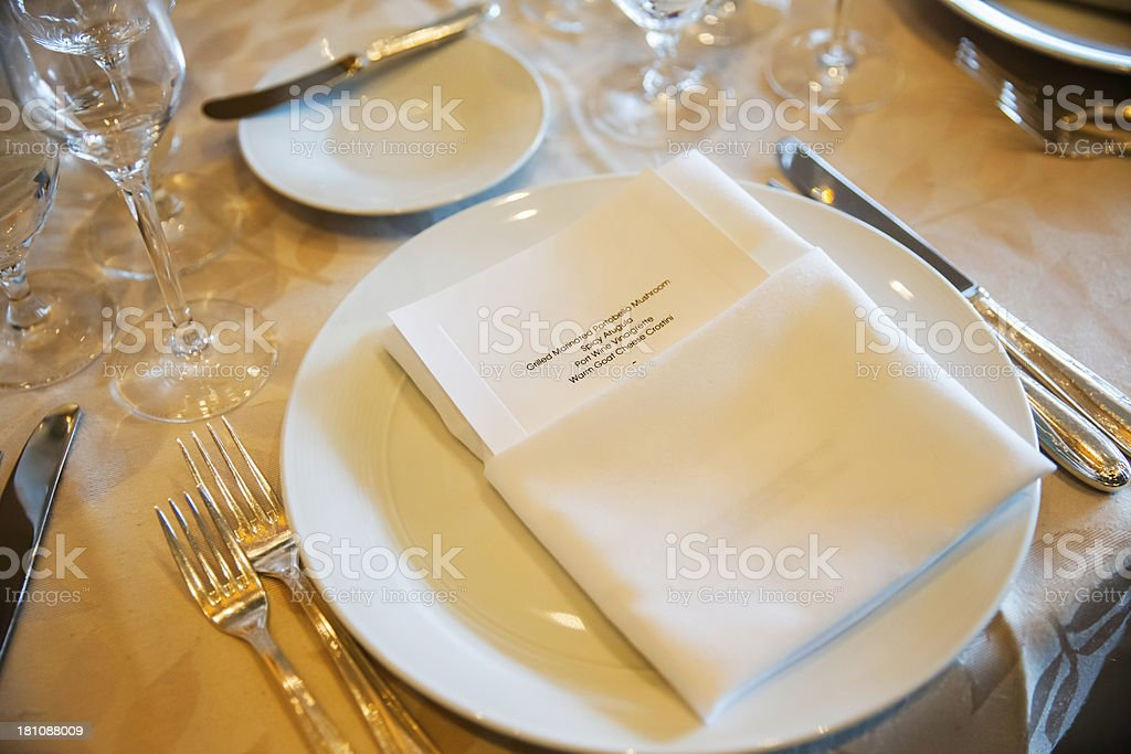Banquet menu on a formally set table stock photo