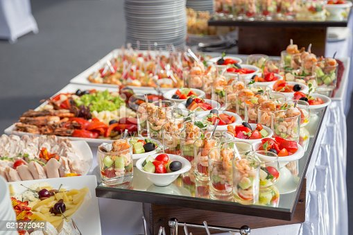 istock Banquet Table in restaurant served with different meals. 621272042