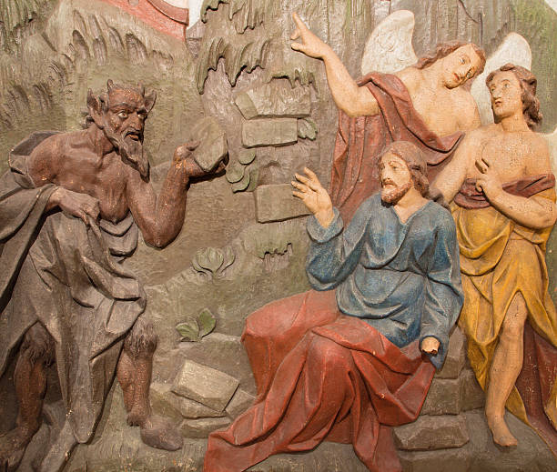 Banska Stiavnica - The Temptation of Jesus carved relief Banska Stiavnica - The carved relief of Temptation of Jesus on the desert as the part of baroque Calvary from years 1744 - 1751 by Dionyz Stanetti. temptation stock pictures, royalty-free photos & images