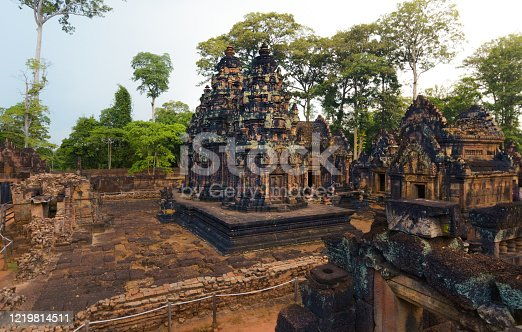 Stone and brick stupas in Banteay Srei, the finest ornate ancient temple in Angkor Wat Unesco park, Siem Reap, Cambodia