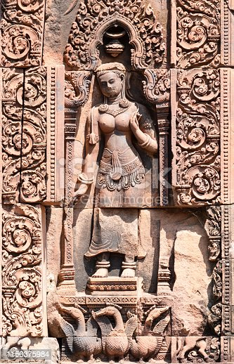 Wall carving of a woman on the walls of Banteay Srei ancient hindu temple in Cambodia close to Angkor Wat archaeological area