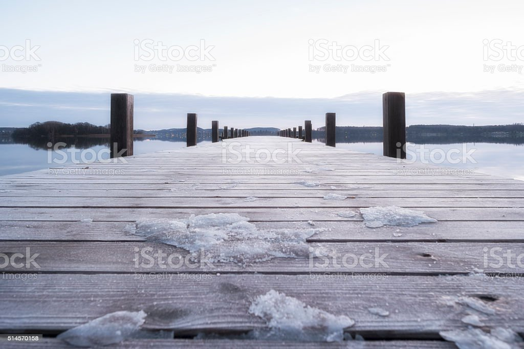 Baordwalk, with snow and ice at the Lake Ammersee, Bavaria stock photo