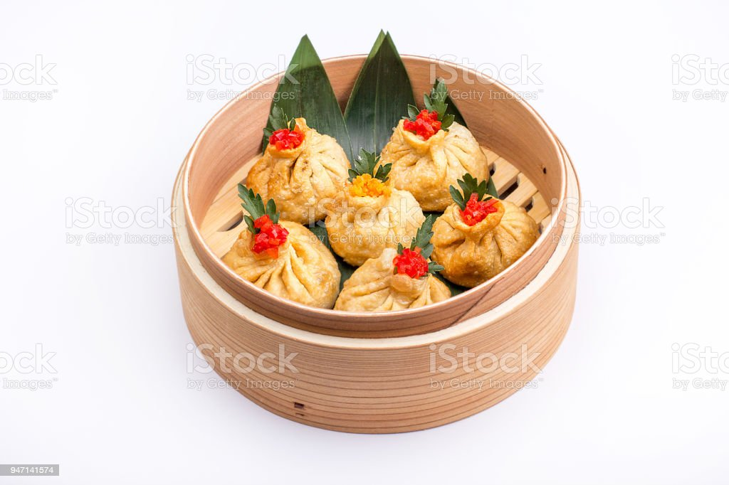 Baozi or munsun, or simply bao - a popular Chinese dish, which is a small pie, steamed. stock photo