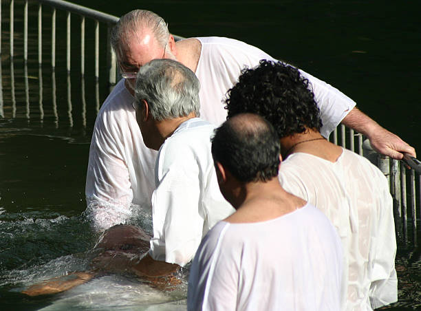 Baptising in the Jordan River stock photo