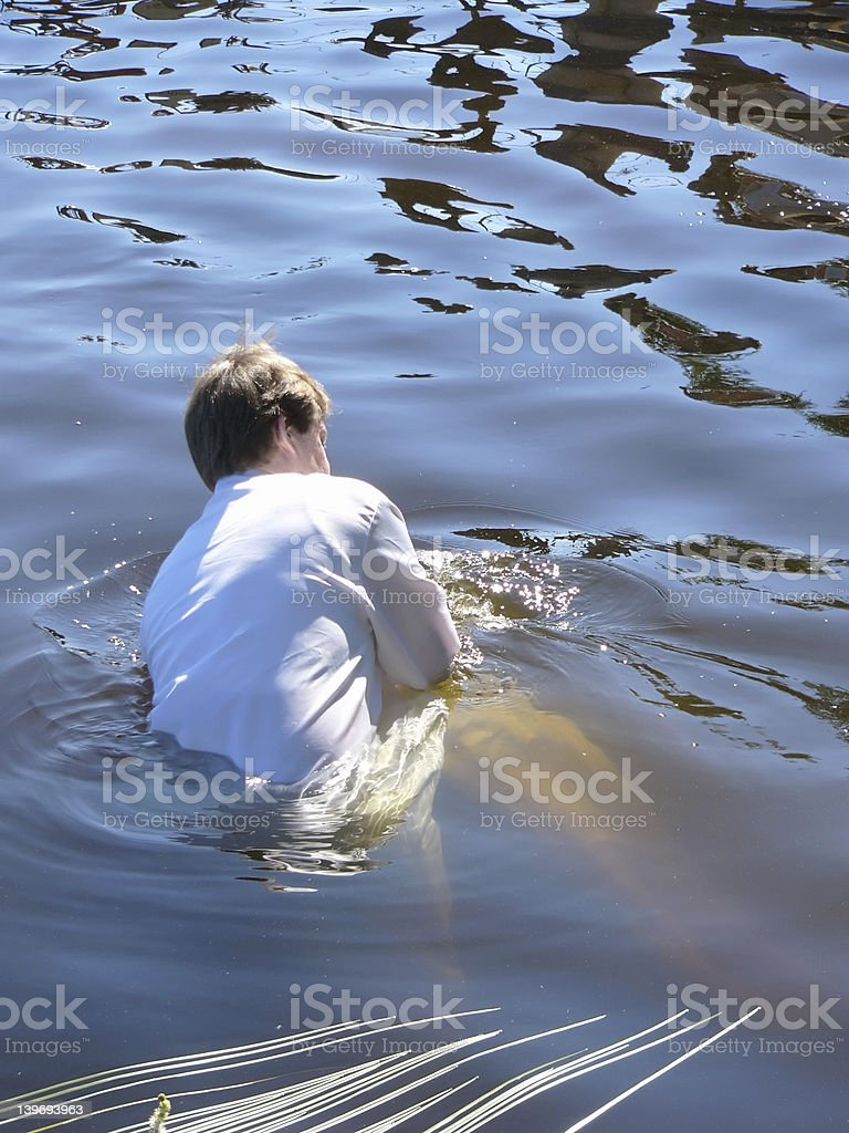 baptism by immersion in a lake stock photo