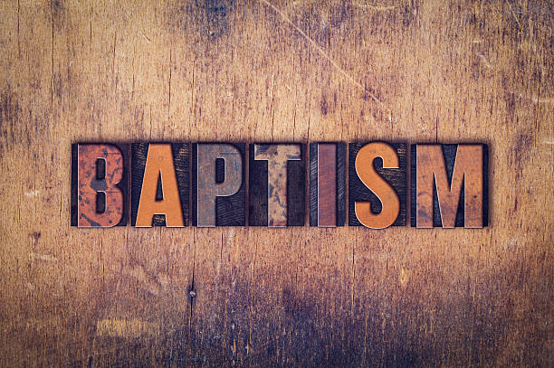 baptism concept wooden letterpress type - baptême photos et images de collection