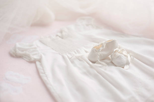 Baptism Gown with Booties & bonnet stock photo