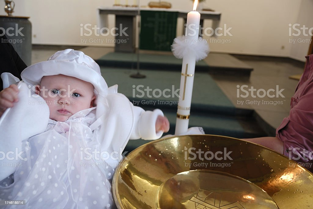 baptism series- baby beside font stock photo