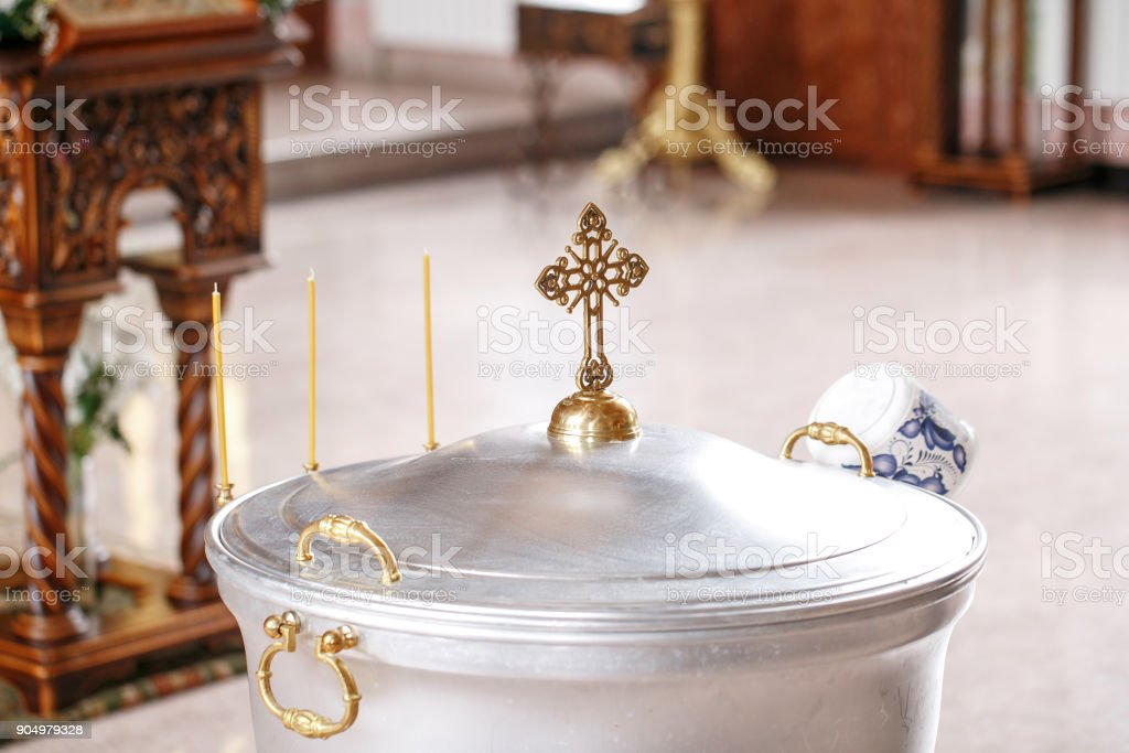 baptismal font. Accessories for the christening of children icons of candles, the Ortodox Church. The Sacrament of Children stock photo