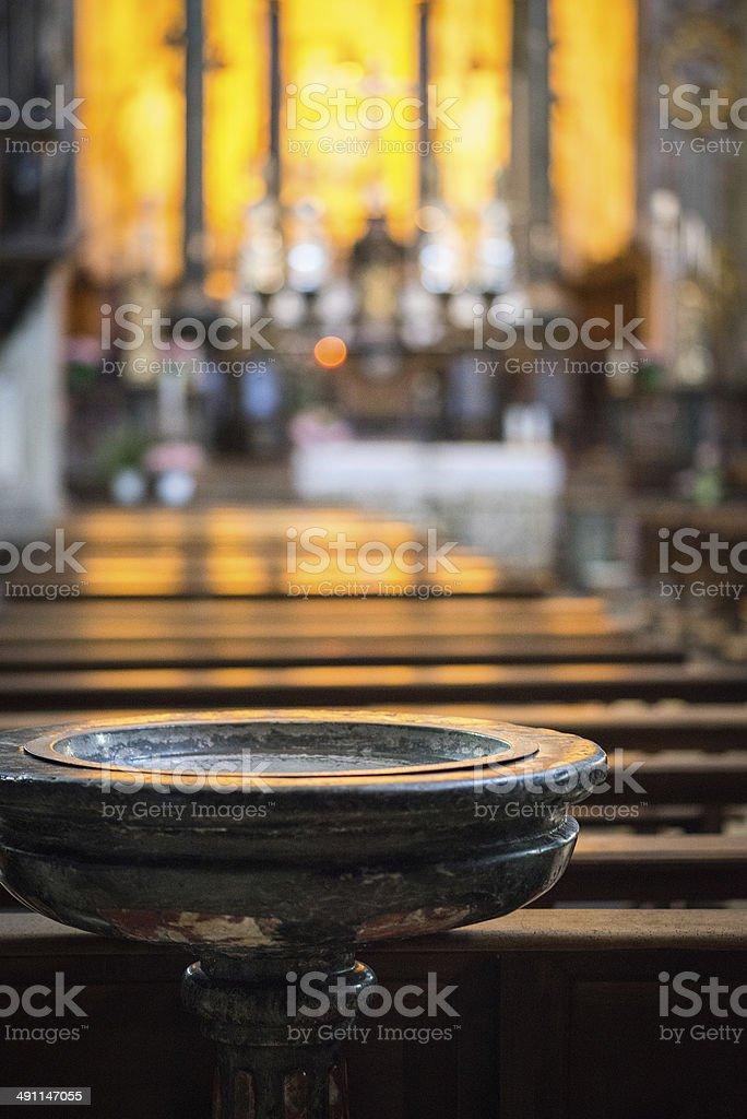 Baptismal font in Italian church stock photo