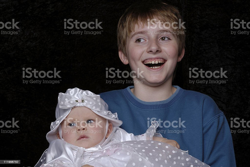 Baptisme series-brother and baby stock photo