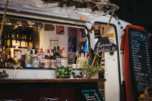 Bar and drinks truck stand in Mercato Metropolitano, London, UK. London, UK - November 2, 2018: Bar and drinks truck stand in Mercato Metropolitano, the first sustainable community market in London focused on revitalising the area and protecting environment. mercato stock pictures, royalty-free photos & images