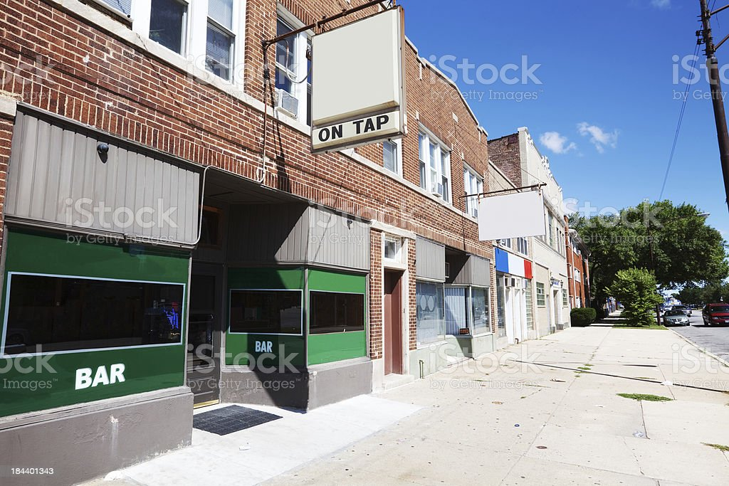 Bar and shops on Grand Avenue in Montclare, Chicago royalty-free stock photo