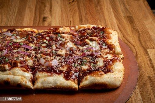 Bar B Q chicken Pizza bar food on a wood table
