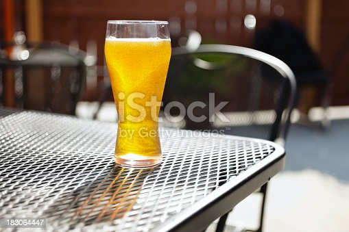 istock Bar Beer Glass on an Outside Pub Patio Table 183064447