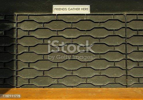 593305530istockphoto bar black wall with table 1152111775