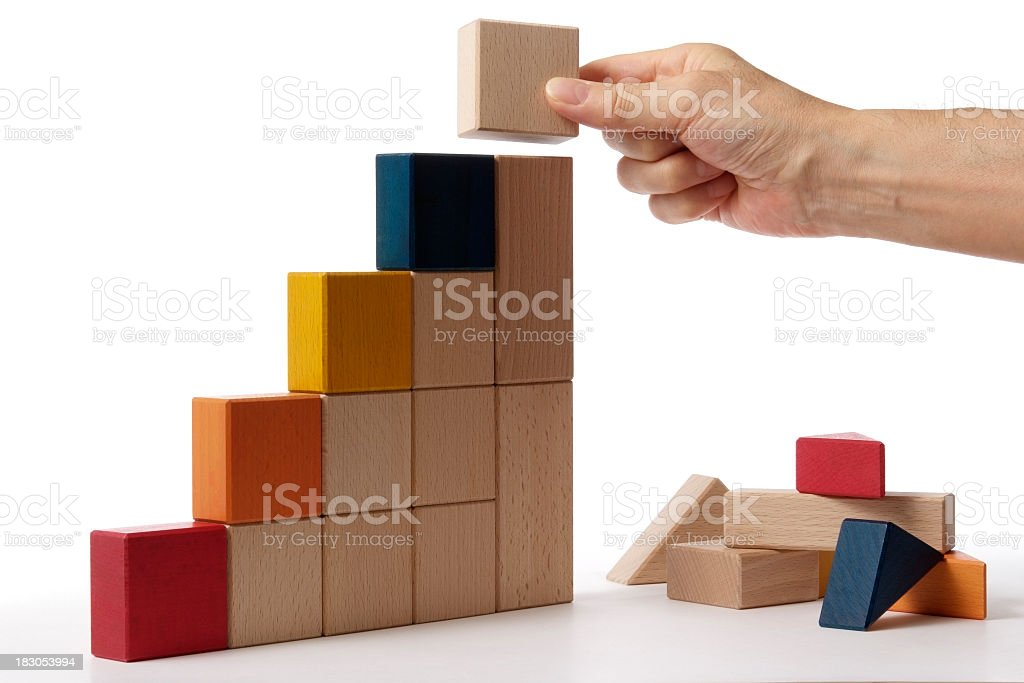 Bar chart made by hand from blocks on white background stock photo