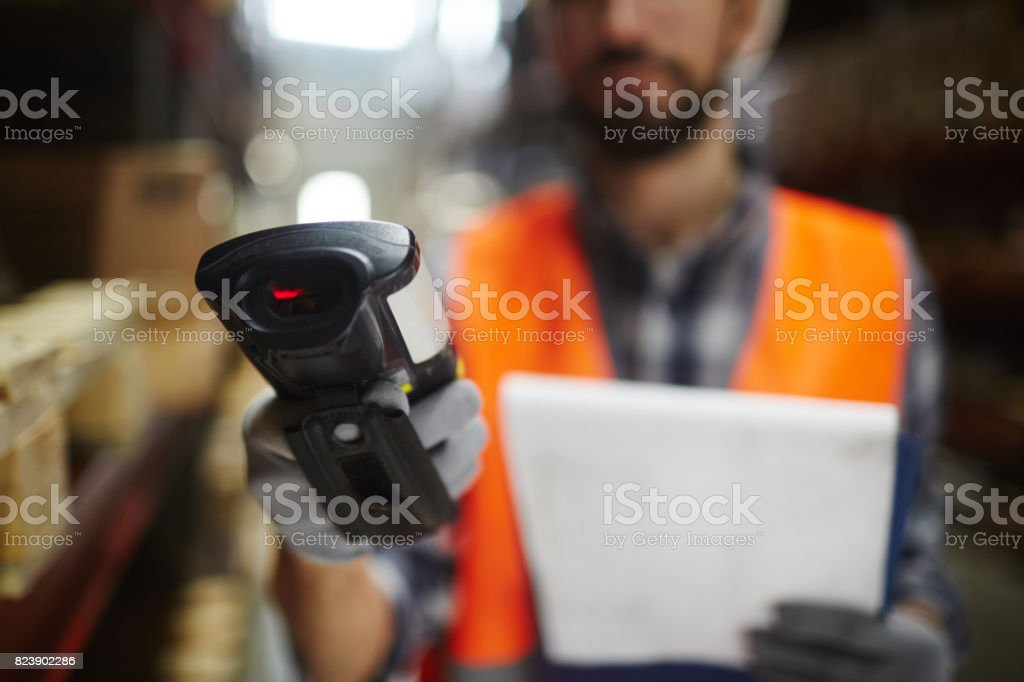 Bar Code Reader Closeup of bar code scanner in hand of unrecognizable warehouse worker doing inventory of stock Bar Code Stock Photo