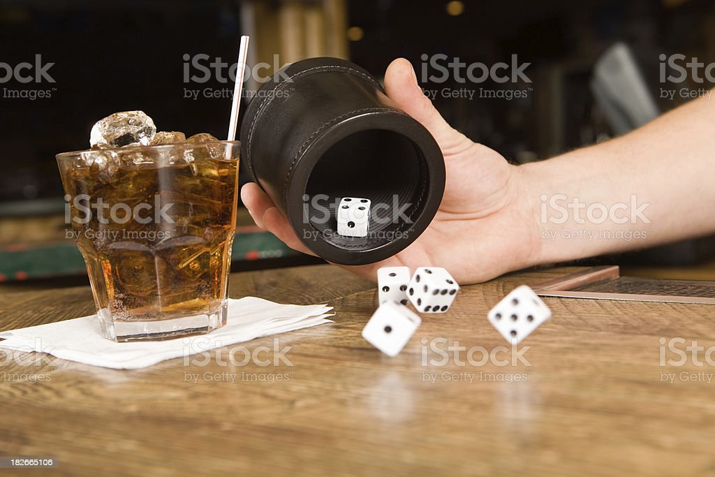 Bar Dice Rolled from a Cup stock photo