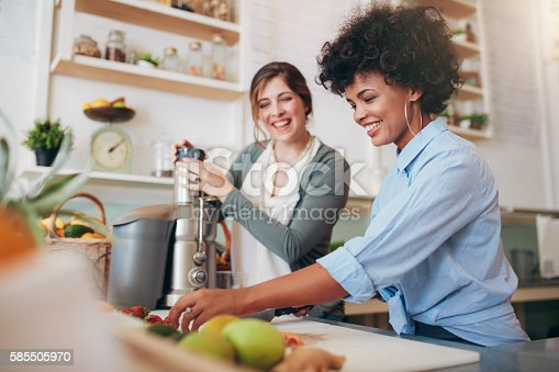 istock Bar employees preparing organic and fresh juices 585505970