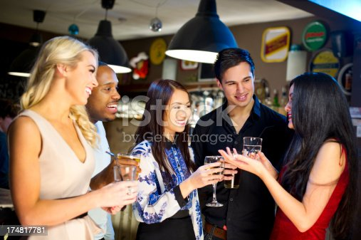 1125634038 istock photo bar friends 174817781