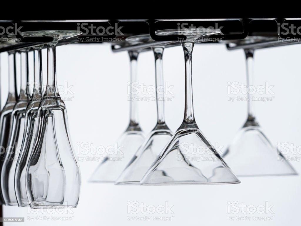 Bar Glasses Hanging Upside Down White Background stock photo