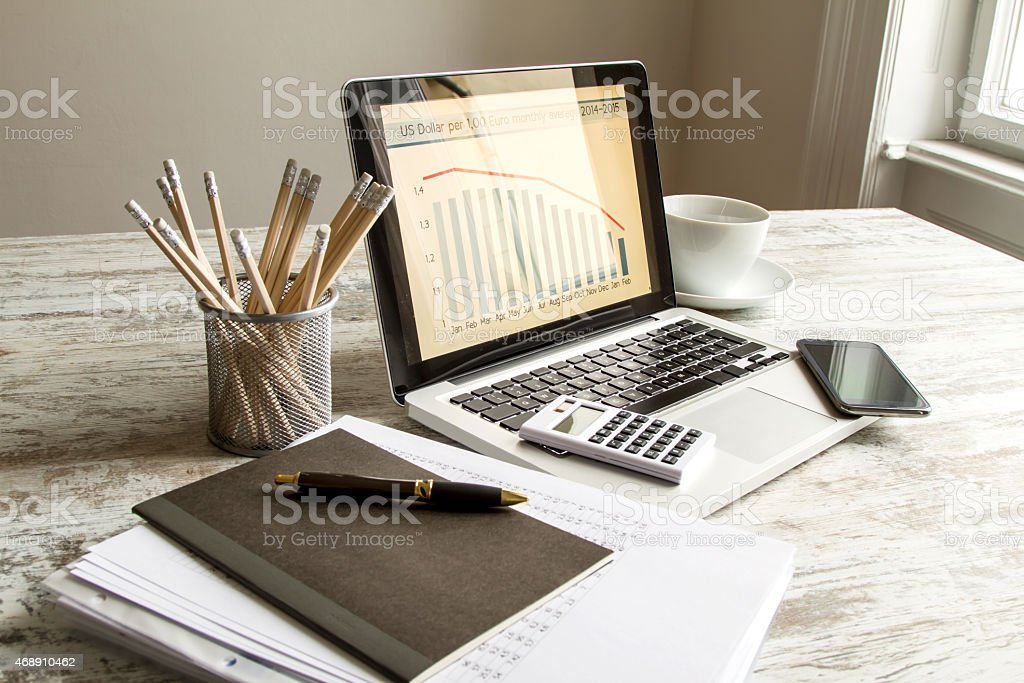A bar graph of the exchange rate euro to dollar on a laptop stock photo