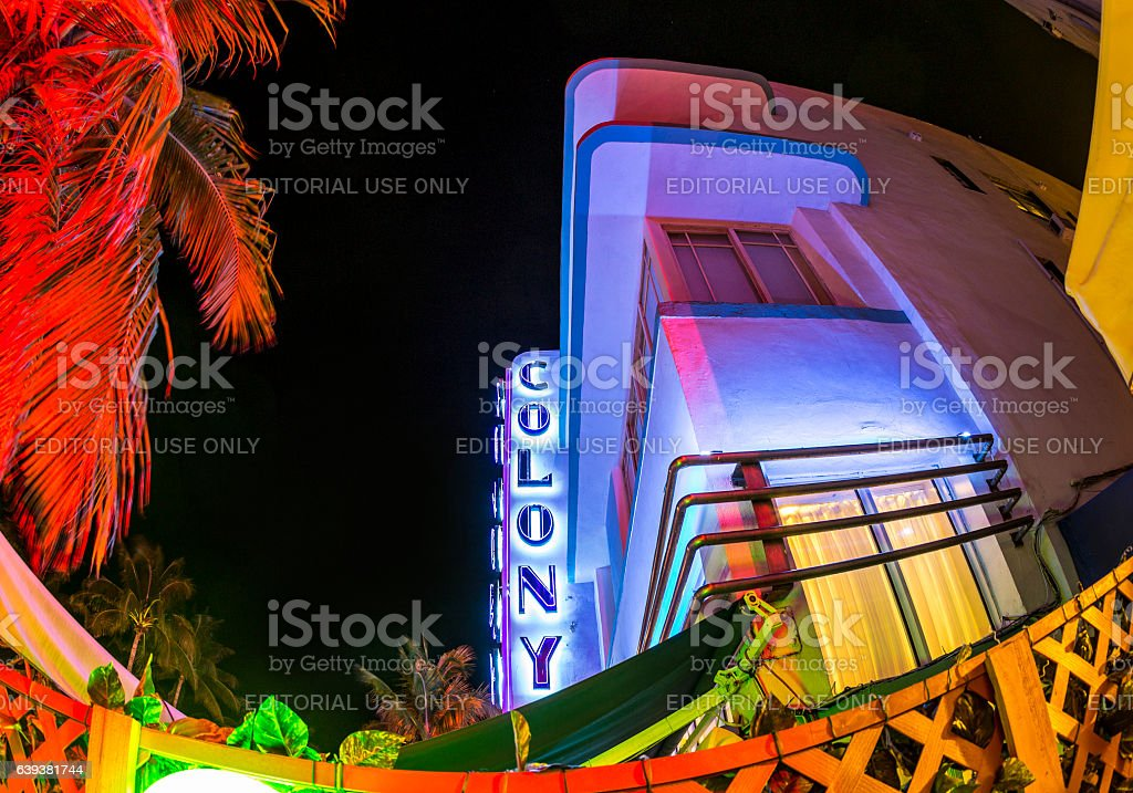 bar, hotel and restaurant at night at Ocean drive stock photo