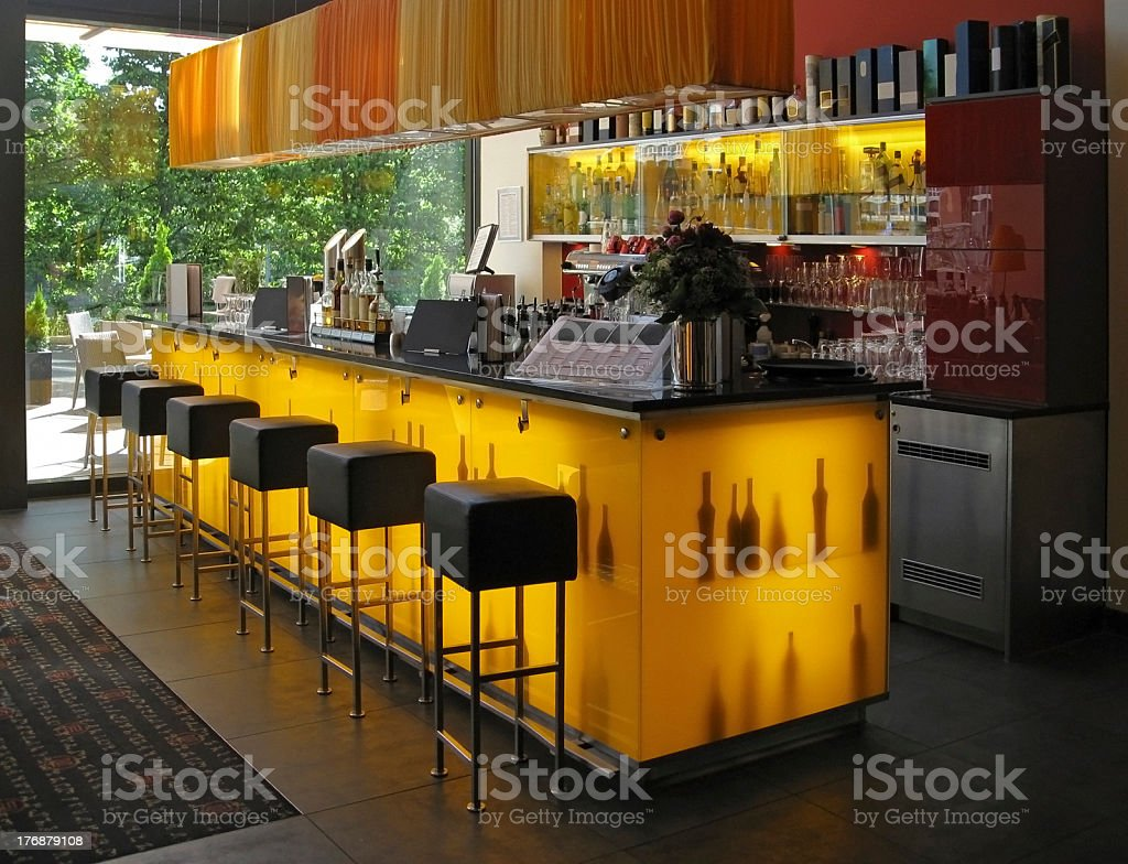 Bar interior with black square stools stock photo