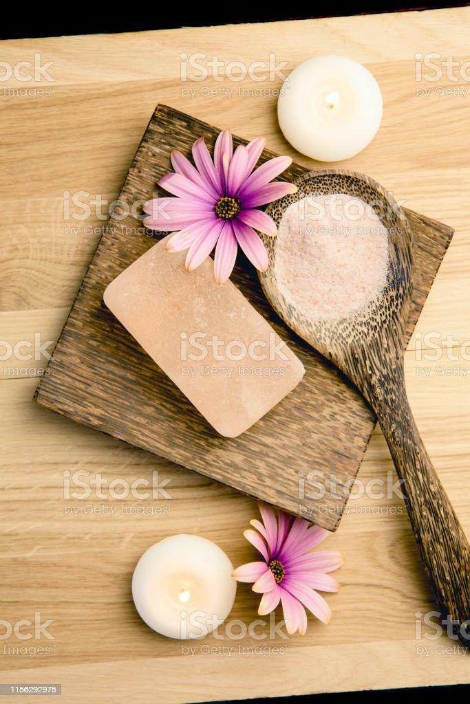 Bar of orange dry Himalayan crystal Salt Soap on wooden background...