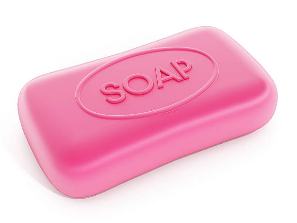 Bar of pink soap isolated on white. stock photo