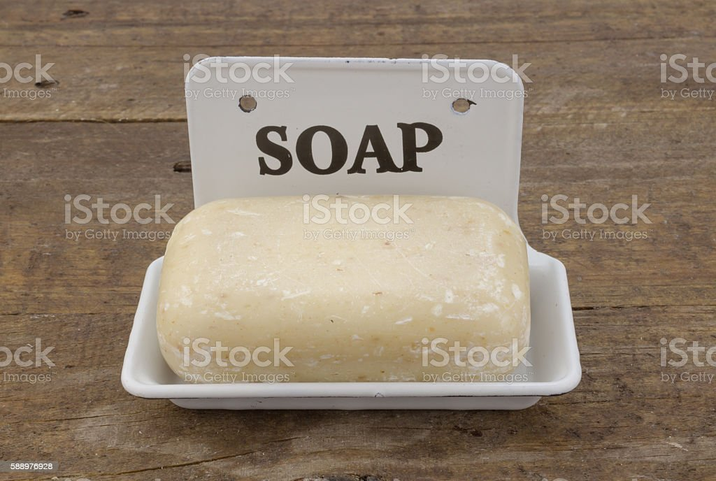 Bar of soap in vintage soap dish stock photo