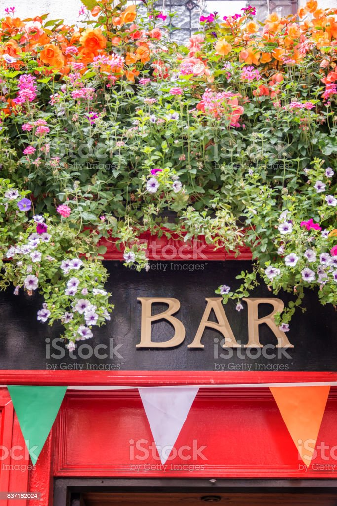 Bar sign with flowers and irish flag colors, irish pub concept in Dublin, Ireland stock photo
