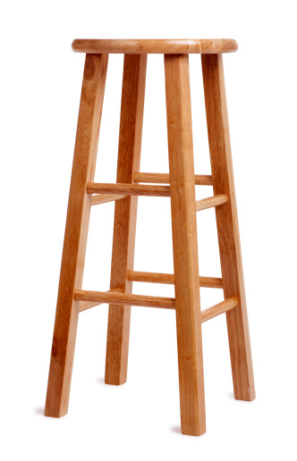 This is a photo of a tall wooden stool on a white background. There is a clipping path included with this file.