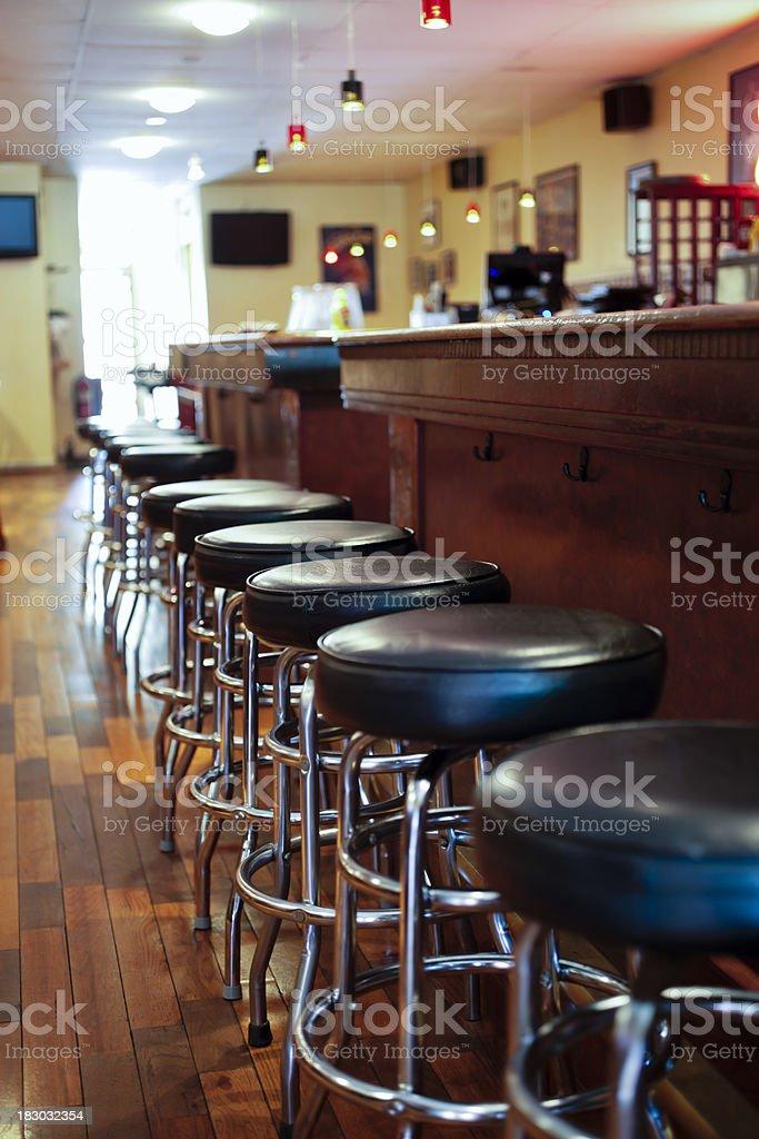 Bar Stools in a Sports Pub Tavern royalty-free stock photo
