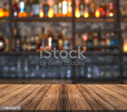 Bar with blurred lights bokeh and wooden table