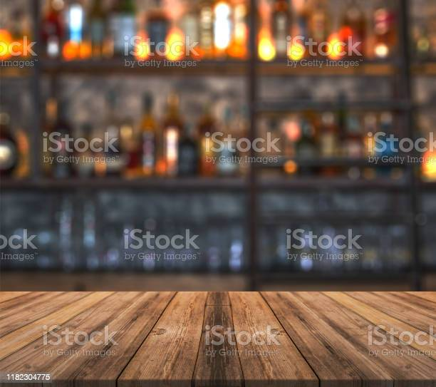 Bar with blurred lights bokeh and wooden table bar with blurred and picture id1182304775?b=1&k=6&m=1182304775&s=612x612&h=zp0rzscyfde1tsjhocnuq7lrm9tqduqwvxybchiuqfa=