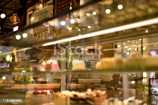 885959540istockphoto Bar with dim cozy lighting, shop window lights. 1184880994
