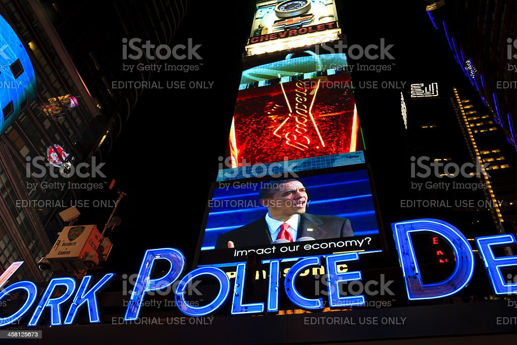Barack Obama in the screens of Times Square royalty-free stock photo