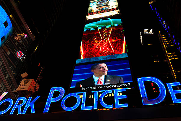 """Barack Obama in the screens of Times Square """"New York City, USA - February 2, 2009: Barack Obama in the screens of Times Square"""" barack obama stock pictures, royalty-free photos & images"""