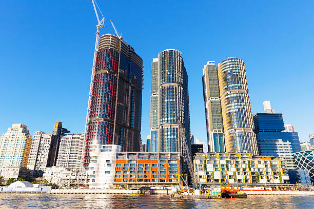 barangaroo construction site, sydney australia, view from water - barangaroo stock photos and pictures