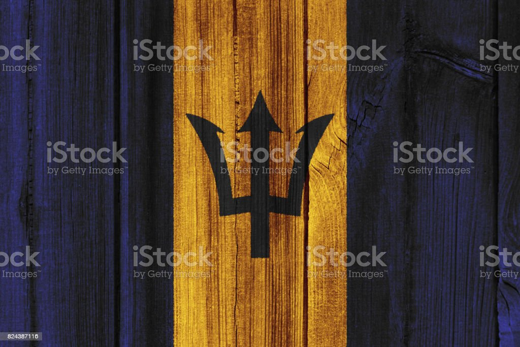 Barbados flag painted on wooden wall for background stock photo