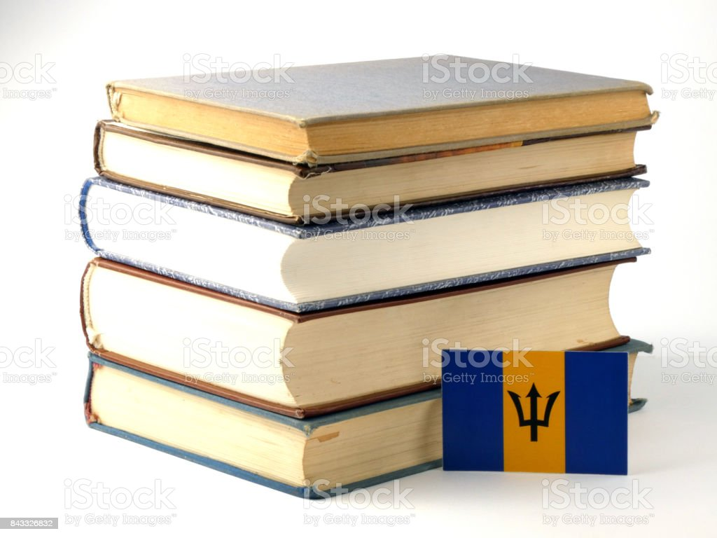 Barbados flag with pile of books isolated on white background stock photo