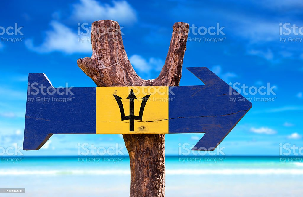 Barbados Flag wooden sign with beach background stock photo