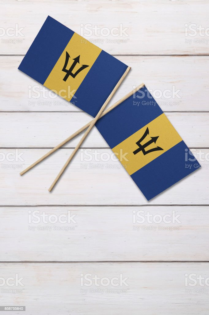 Barbados Two flags on a painted wood background stock photo