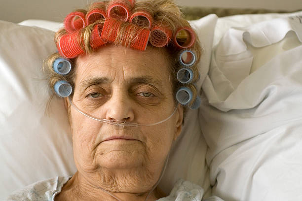 Barbara An older woman in the hospital with curlers in her hair, hooked up to oxygen oxygen tube stock pictures, royalty-free photos & images